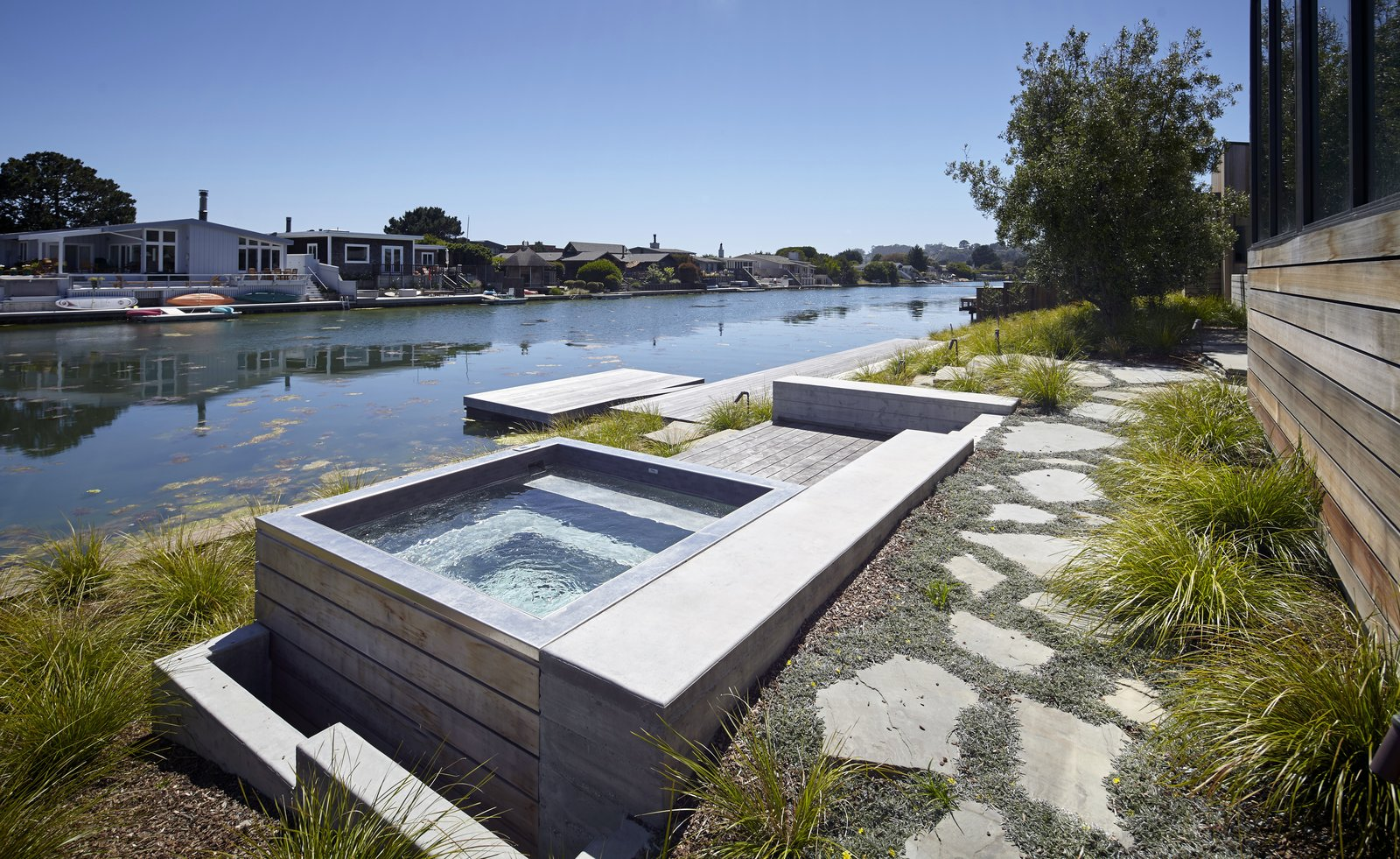 #TurnbullGriffinHaesloop #outdoor #landscape #hottub #lagoon #dock  Stinson Beach Lagoon Residence by Turnbull Griffin Haesloop Architects