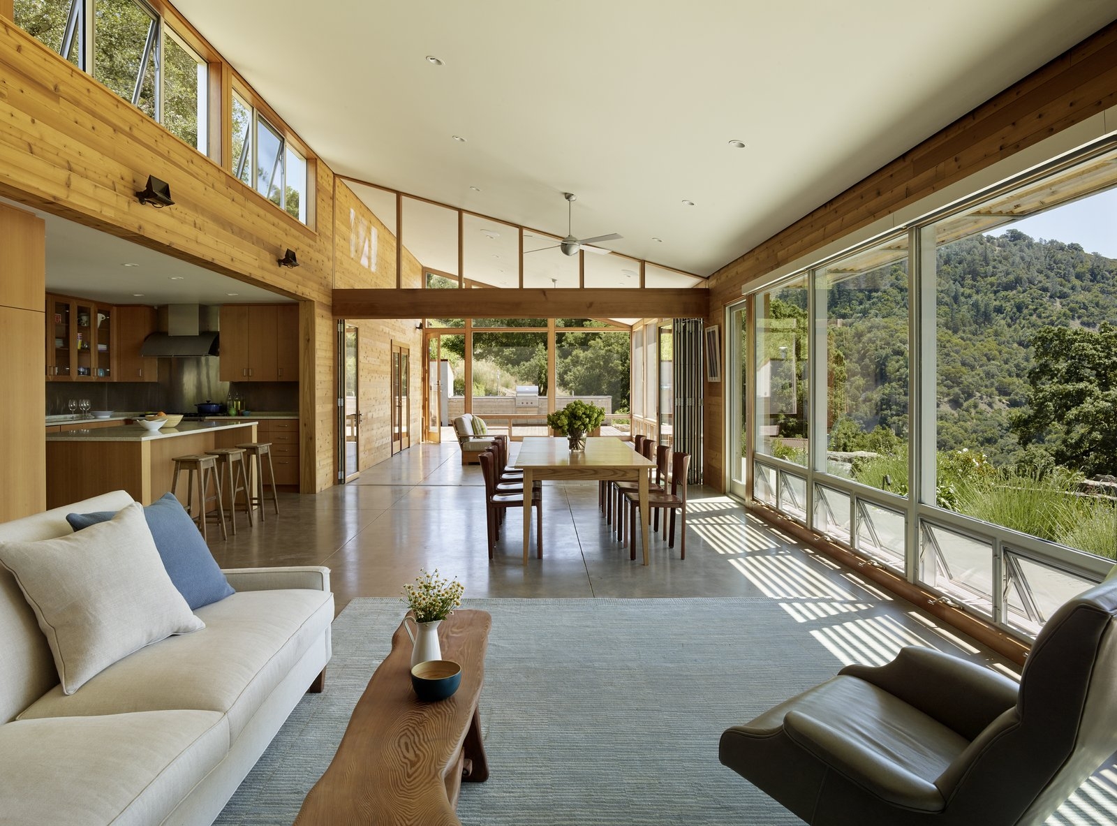 #TurnbullGriffinHaesloop #interior #nanawall #livingroom #diningroom #screenedporch #window Tagged: Living Room, Sofa, Chair, Table, Recessed Lighting, and Concrete Floor.  Cloverdale Residence by Turnbull Griffin Haesloop Architects