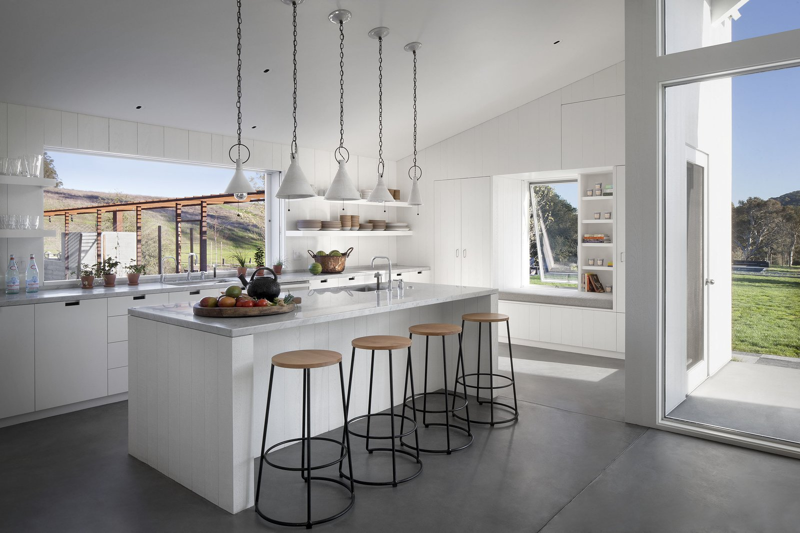 #TurnbullGriffinHaesloop #interior #kitchen #window Tagged: Kitchen, Pendant Lighting, White Cabinet, Marble Counter, and Concrete Floor.  Hupomone Ranch by Turnbull Griffin Haesloop Architects