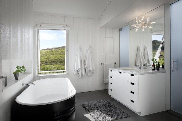 Modern home with bath room, freestanding tub, and concrete floor. #TurnbullGriffinHaesloop #interior #bathroom #bathtub #window Photo 9 of Hupomone Ranch