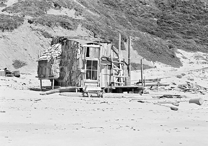 Driftwood shelter built by hippies and surfers on Agate Beach, Bolinas, California during summer 1971.  Photo by Walter Rawlings  Surf Shacks by Chris Deam