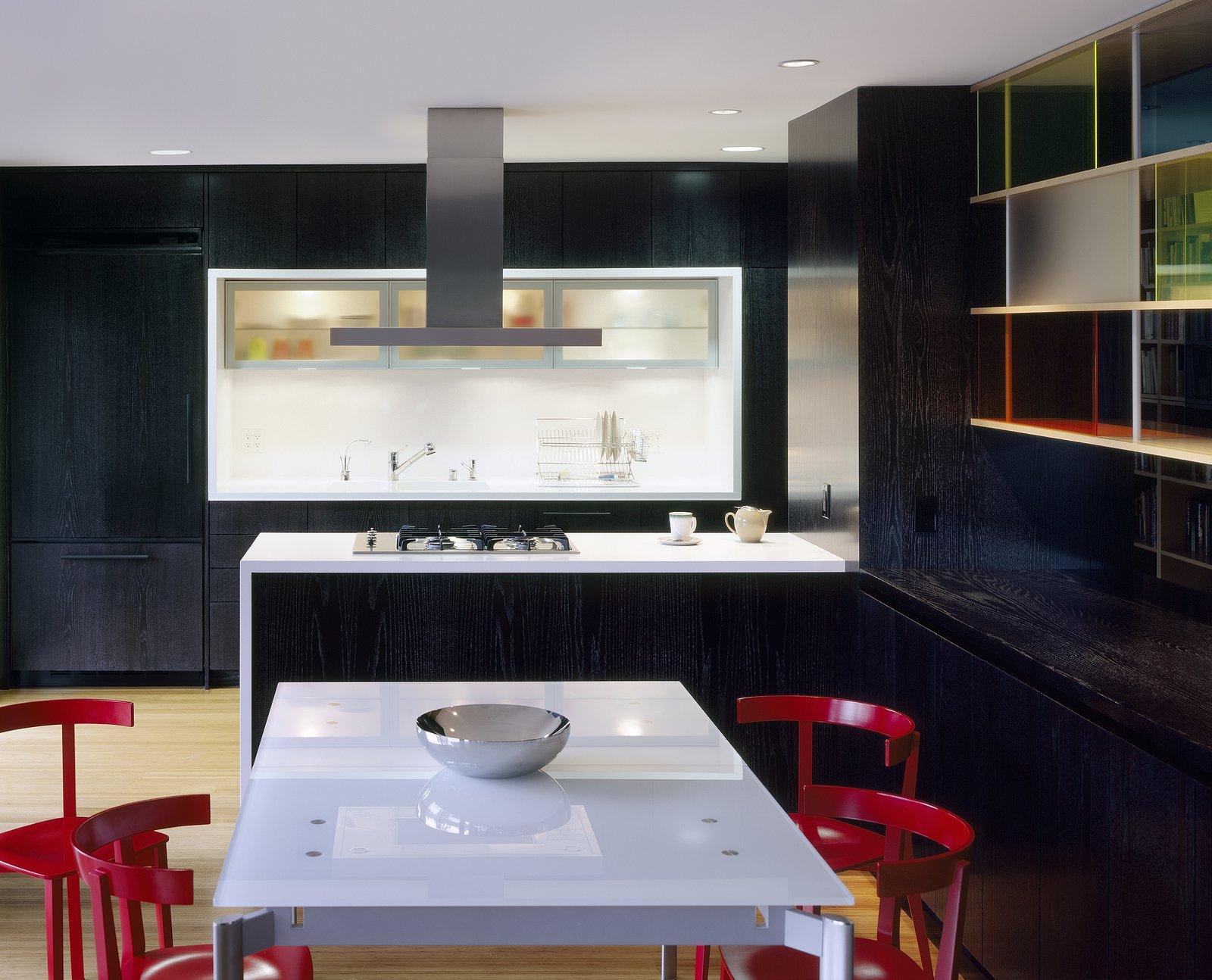 Kitchen and dining room with custom aluminized/ebonized oak casework