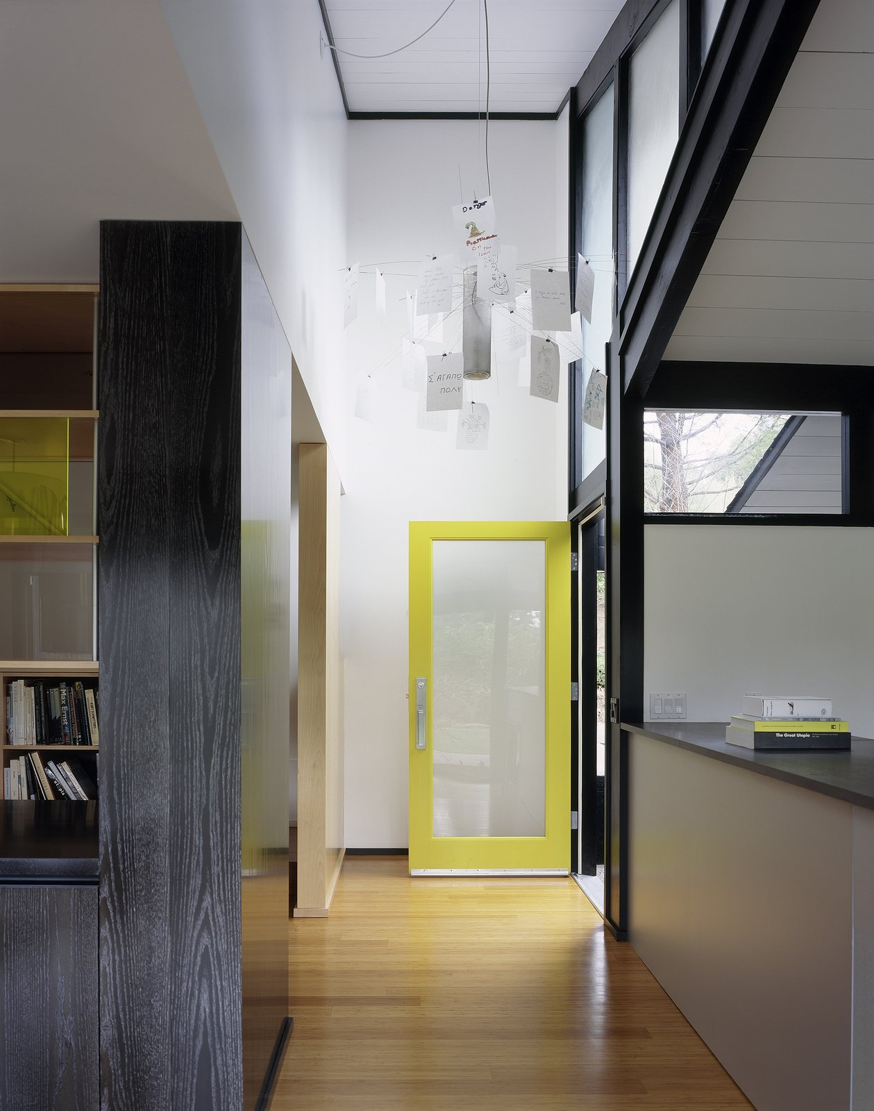 Entry hall with Ingo Mauer chandelier  Home for a Professor by Chris Deam