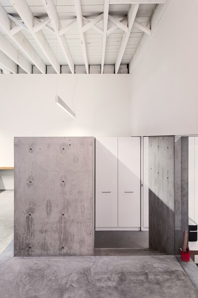 The walls and ceiling were whitewashed and new concrete was poured to give the workspace a clean and minimal palette.