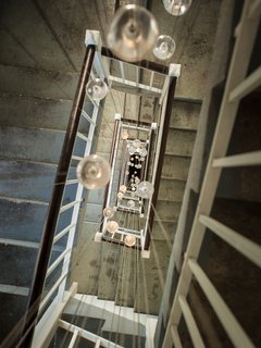 Inside the Head Office of Bocci - Photo 5 of 7 - 120 glass pendants from Bocci's 14-series illuminate the back staircase.