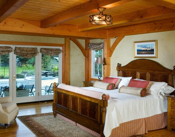 The Timber Framed Master Bedroom has Direct Pool Access Photo 15 of Yellow Brook Farm House modern home