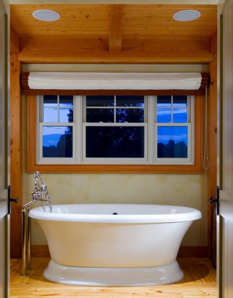 Deep Soaking Tub in the Master Bathroom Photo 17 of Yellow Brook Farm House modern home