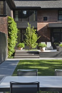 25 Blissful Backyards - Photo 22 of 25 - A modern brick home with an incredible backyard.