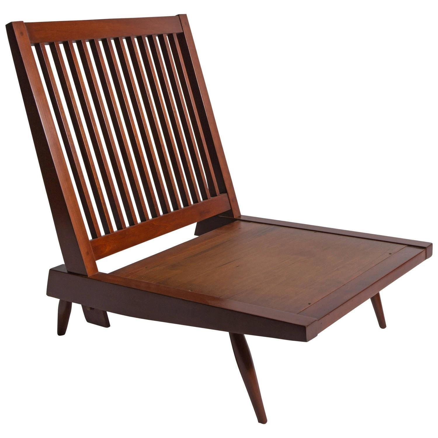 George Nakashima Studios walnut lounge chair from the mid-1950s.  Photo: reGeneration.  lounge chairs by pulltab