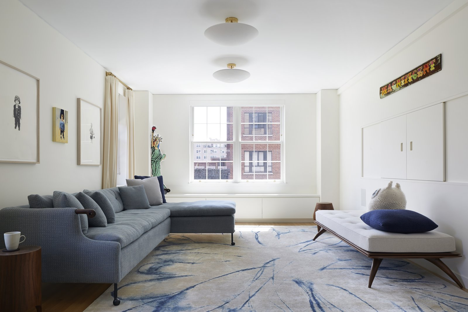 View from the entry to the Living Room.  Furniture by BDDW, Paul Mathieu and Kieran Kinsella.  The area rug is by Fort Street Studio.  The cast plaster ceiling fixtures are by Pulltab and Remains Lighting.   from 5th Avenue Residence