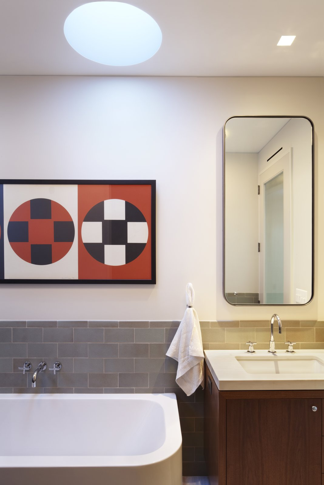 A detail photo of the master bath in the penthouse addition.  Here highlighting some of our favorites - tile from Heath Ceramics, plumbing fittings by Dornbracht, bathtub and sink by Duravit and an Arne Jacobsen hand towel ring by Vola.  The medicine cabinet was custom made to our specifications and has a cold rolled blackened steel frame.