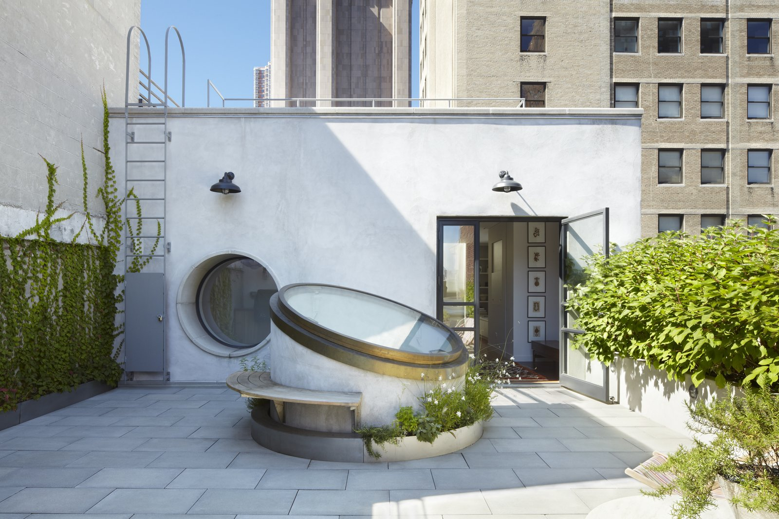 Roof garden - skylight in closed position.  White Street Residence by pulltab