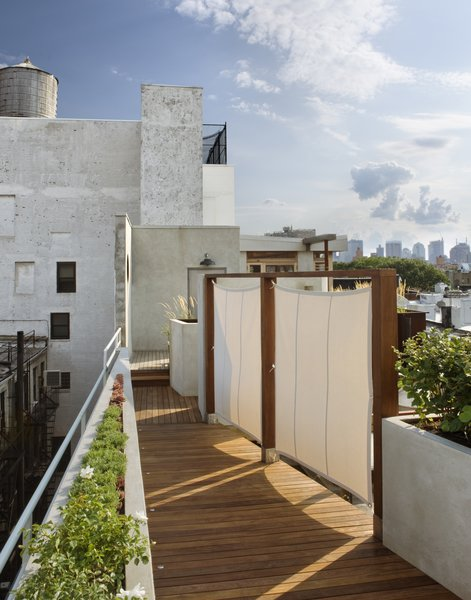 Walking back down the ramp toward the penthouse in the late afternoon sun. Photo 12 of East Village Roof Garden modern home