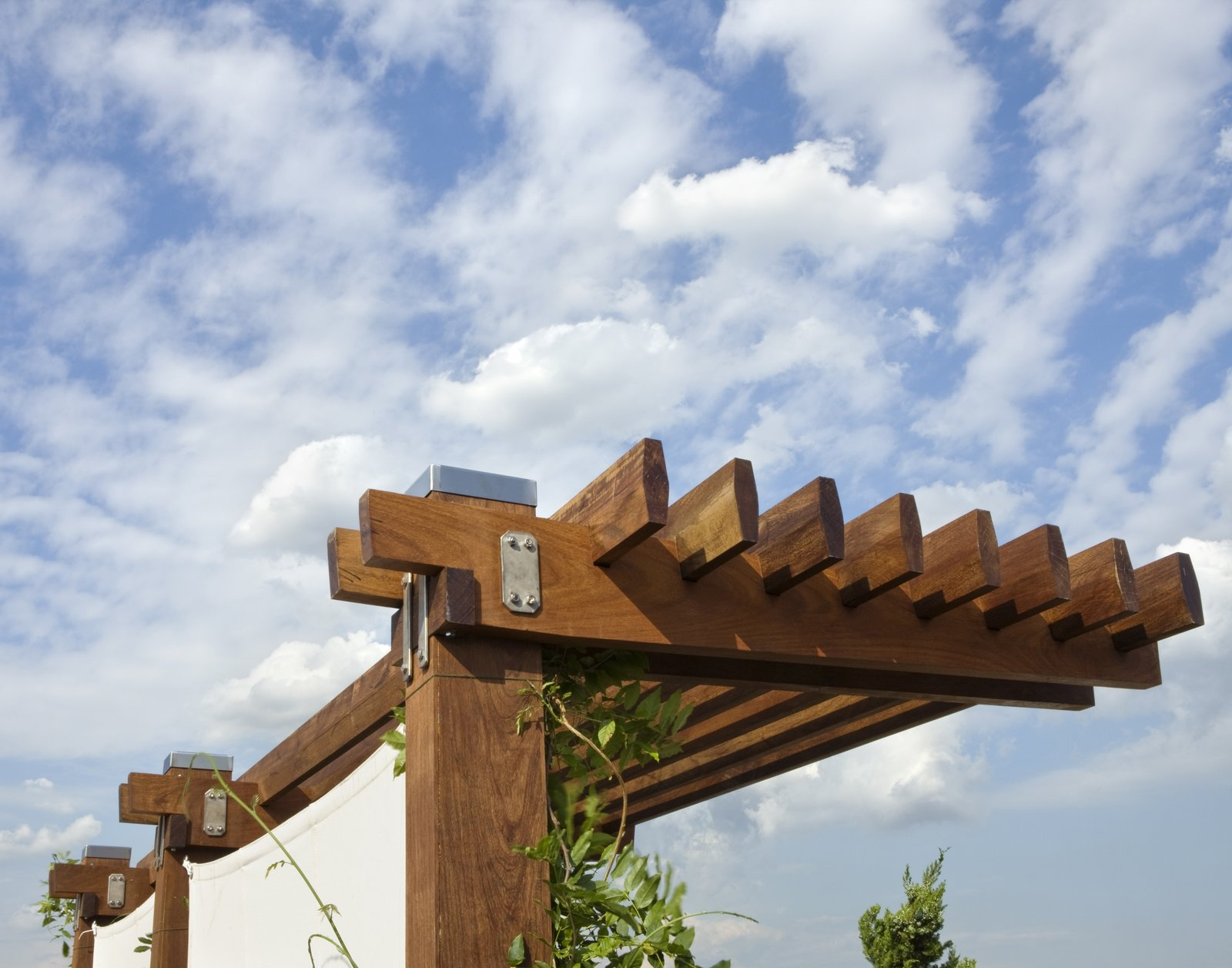 The pergola was fabricated from solid Ipe and is assembled using stainless steel bolts and plates.  East Village Roof Garden by pulltab