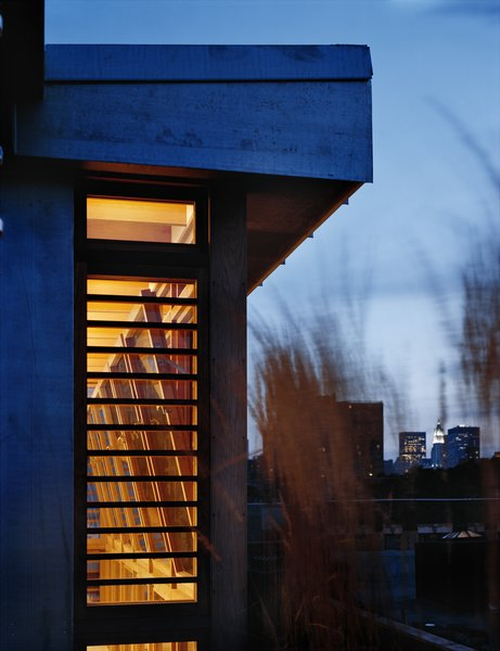 At night the penthouse addition shines with a warm glow. Photo 7 of East Village Penthouse & Roof Garden modern home
