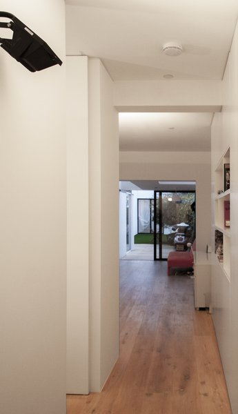 From the entry one gets elongated views toward the back of the scheme but the full extent of the space is elusive, with glimpsed views into spaces beyond, both laterally and longitudinally. Photo 9 of Unité de Rénovation modern home