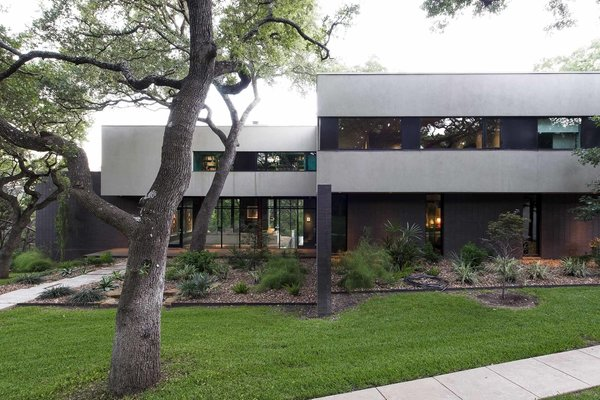 Located on a wooded lot in West Lake Hills, Paul and Jessica D'Arcy's peaceful retreat feels worlds away from Austin, yet is just five miles from city's buzzing downtown.  The couple first listed their home on Airbnb nearly three years ago.  Photo 2 of 8 in An Austin Airbnb Is a Blissful Getaway