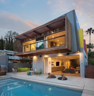 "These 11 Modern Homes in Southern California Offer an Indoor/Outdoor Lifestyle - Photo 2 of 11 - The ""hanging"" porch and open den areas of this modern Los Angeles home are integrated into the outdoor space, allowing the homeowners to enjoy the California weather. The exterior wood siding is just one of the many stunning architectural elements."