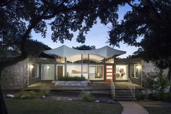 Modern home with outdoor, front yard, grass, concrete patio, porch, deck, and small patio, porch, deck. Photo  of Butter Fly House : A. D. Stenger