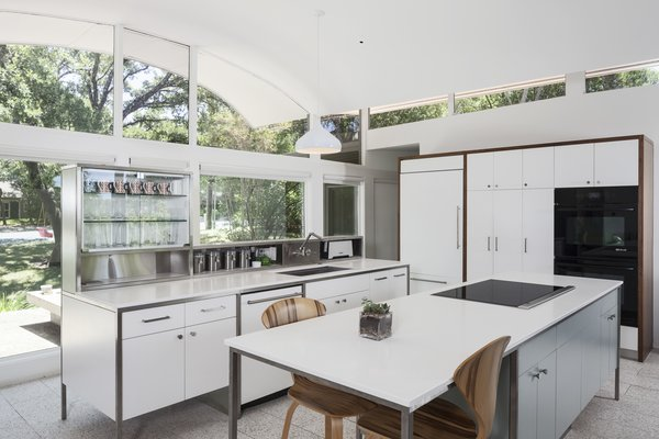 Modern home with kitchen, white cabinet, metal backsplashe, and ceramic tile floor. Photo 2 of Butter Fly House : A. D. Stenger