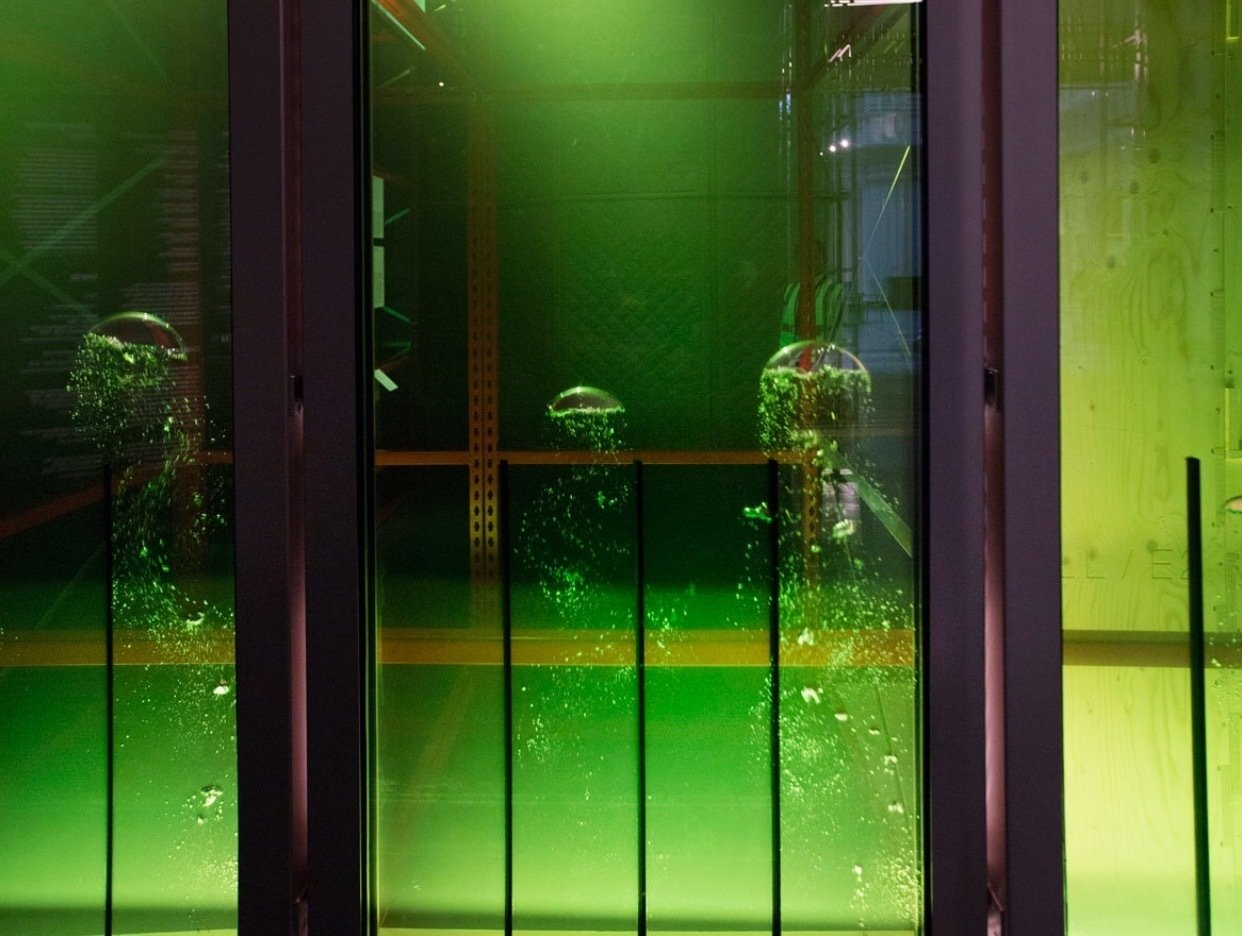 ARUP's SolarLeaf – bioreactor façade The SolarLeaf façade was installed for the first time on the BIQ house for the International Building Exhibition (IBA) 2013.  -First façade system in the world to cultivate micro-algae to generate heat and biomass as renewable energy sources. -Structural glass photobioreactors used as external cladding elements and dynamic shading devices. -Fully integrated in the house´s building services system to harvest, distribute, store and use the solar thermal heat on site. Material Spotlight: Algae by Melissa Abel