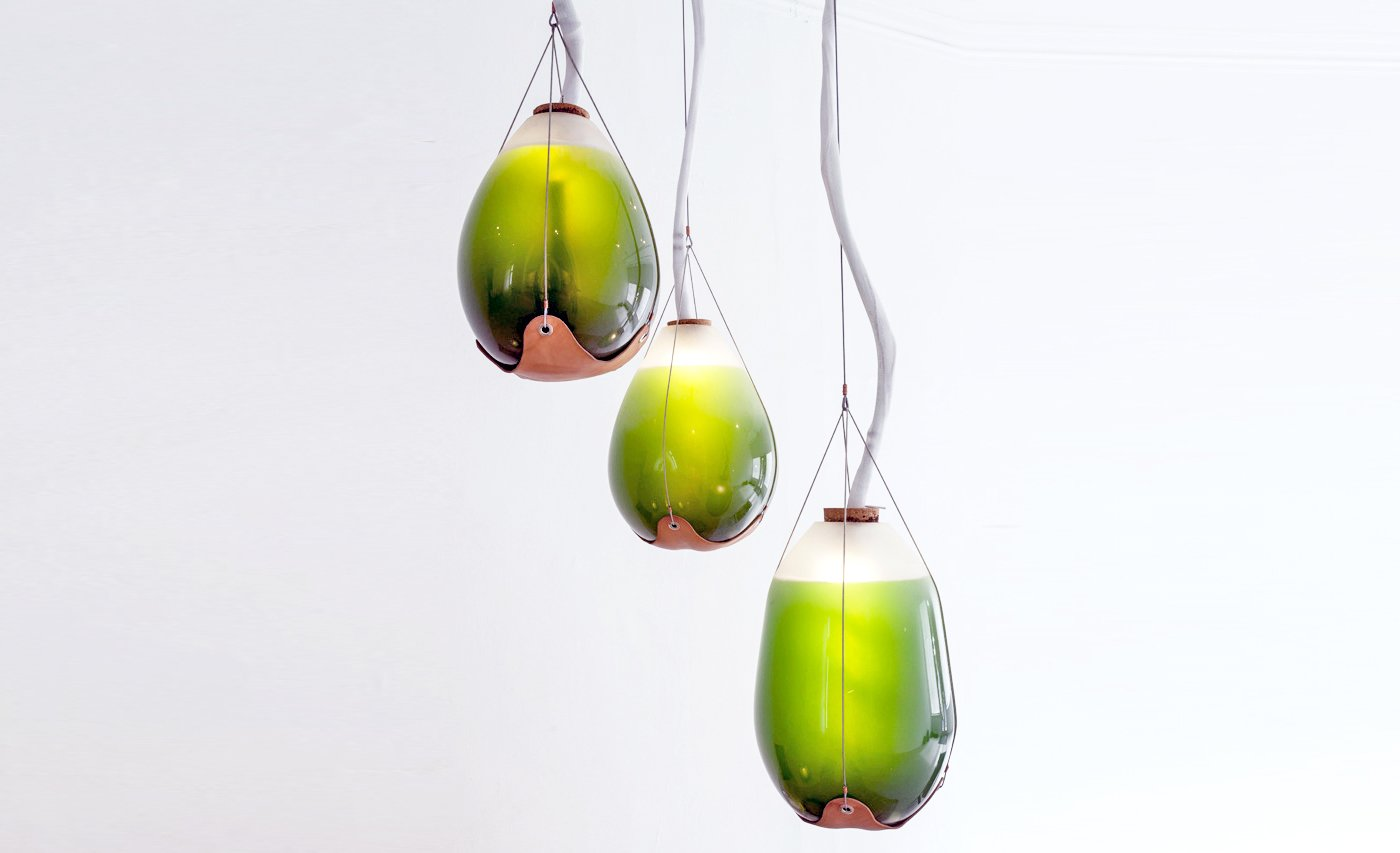 "Jacob Douenias and Ethan Frier -Livings Things: Spirulina Pendant Lamps  ""The morphologies of hand-blown glass vessels function both as lighting and heating elements for the human occupants, and high functioning photobioreactors which provide heat, light, agitation, air supply, nutrient and waste control to the living algae inside,""   Material Spotlight: Algae by Melissa Abel"
