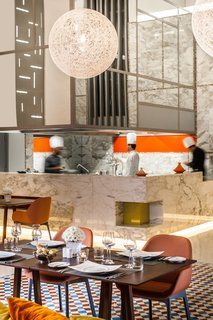 GM Architects' Latest Project: Harmonizing Two Distinct Mediterranean Identities - Photo 5 of 6 - The Sofitel restaurant, Le Marche Des Saveurs, prepares a fusion of Moroccan, French, Asian and Mediterranean cuisine, offering something for everyone.