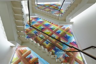 Mural Artist Sets the Scene at Longchamp's Flagship Store in London - Photo 3 of 4 - The mural measures roughly 39 feet high by 16 feet wide, its colorful tessellation the backdrop against which other architectural elements cohere.