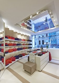 Mural Artist Sets the Scene at Longchamp's Flagship Store in London - Photo 4 of 4 - Lacing reminiscent of Longchamp's LM motif appears across ceiling tiles, wall panels, and product display stands, tying the space together.
