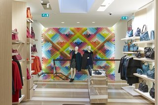 Mural Artist Sets the Scene at Longchamp's Flagship Store in London - Photo 1 of 4 - The prismatic hues of Maya Hayuk's mural complement the hot and cool tones of the merchandise lining the walls.