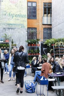A Retired Copenhagen Power Plant Hosts a Design Pop-Up - Photo 4 of 4 - A plant shop occupies a section of the courtyard, where shop visitors can gather over coffee, pastries, ice cream, and more.