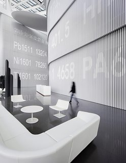 Chinese design firm Hallucinate created a futuristic office for Maike Group - Photo 2 of 3 - A ticker runs along the wall, superimposing digitally the work done in physical space.