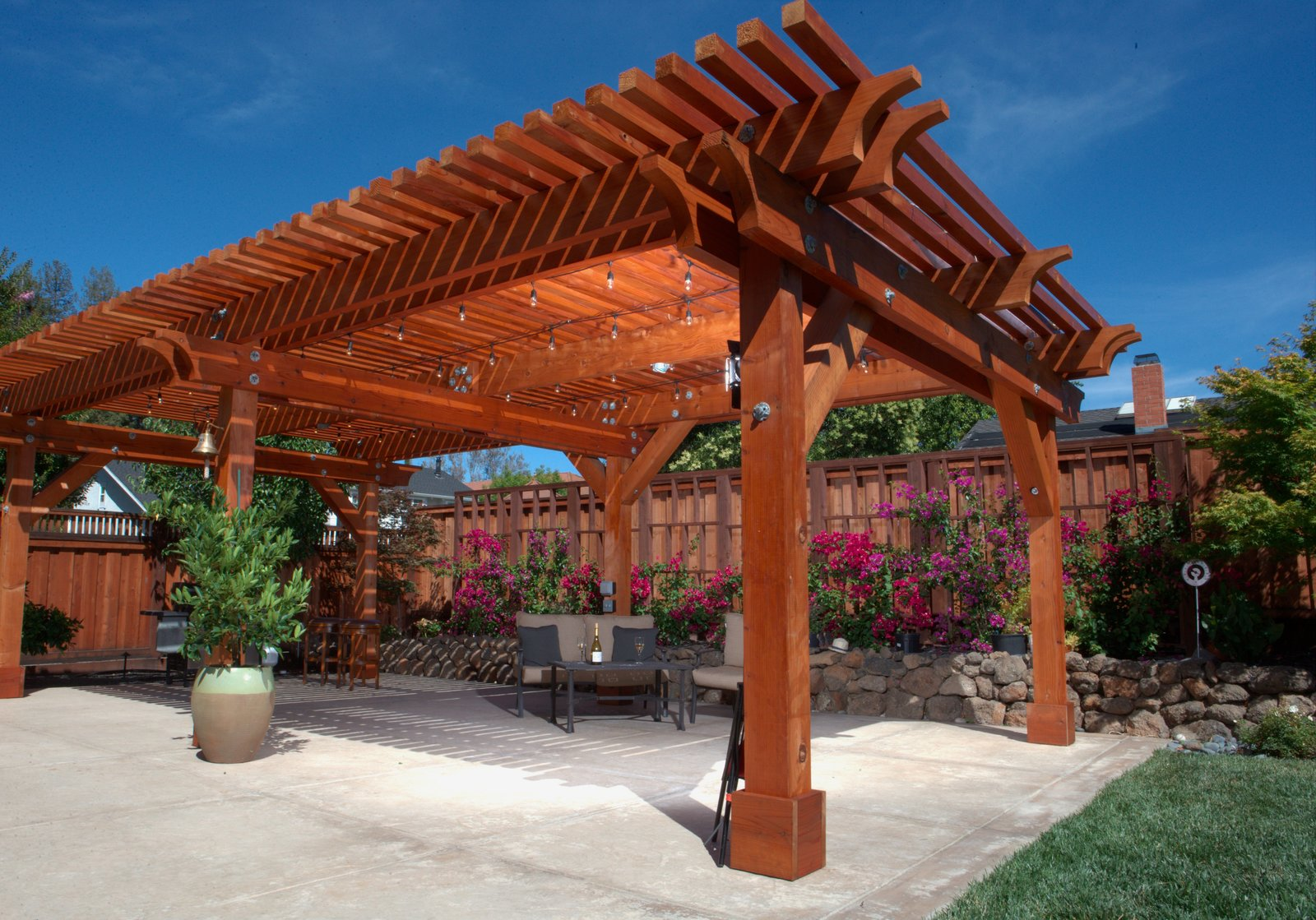 A versatile material, redwood can be left to turn a rustic, silver-tone gray, or finished to take on a glowing tint. A pergola such as this one, which will accompany Humboldt Redwood Company at Dwell on Design, can imbue your backyard space with both stateliness and charm.  Pergolas by Natalie Pinkerton GRI