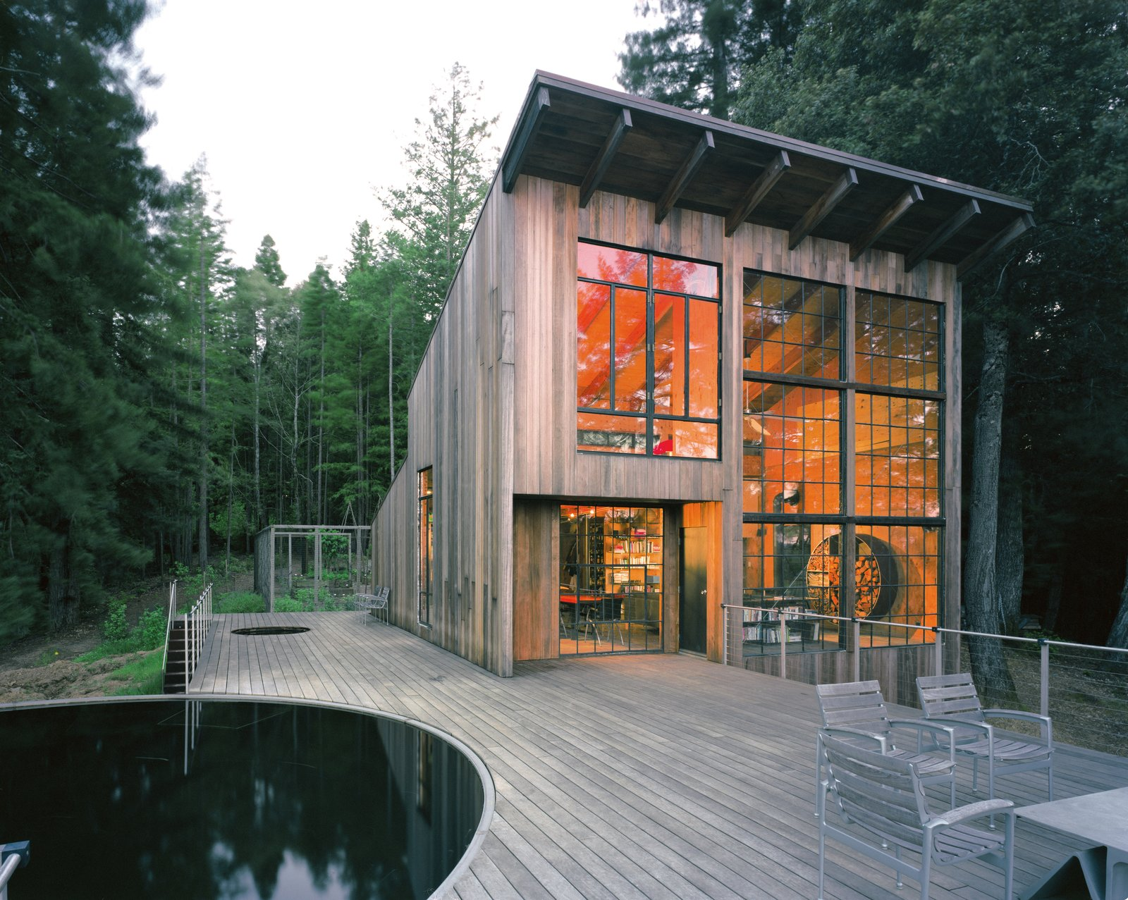San Francisco firm Lundberg Design built this cabin out of reclaimed materials, including the exterior redwood, which has aged into an elegant, ashen gray. In a past life, the pool acted as a water tank for livestock. Tagged: Exterior, House, Cabin Building Type, Wood Siding Material, and Shed RoofLine.  Photo 75 of 101 in 101 Best Modern Cabins from Beauty and Brains: Building Sustainably With Redwood