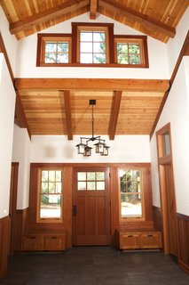 Beauty and Brains: Building Sustainably With Redwood - Photo 5 of 6 - A home in Sonoma County, California uses redwood for the interior beams, trim, and entryway storage to evoke a pastoral warmth.