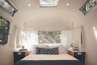 AutoCamp's Modern Clubhouse Emerges from the Russian River Redwoods - Photo 3 of 6 - Airstream suites include queen-sized Casper mattresses with deluxe bedding. The pendant lights are from Schoolhouse Electric.