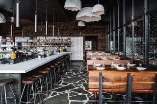 A Spanish Restaurant With an Industrial Infusion - Photo 3 of 5 - Vintage Northern European furniture, shelving, and pendant lights contribute to a rugged impression.