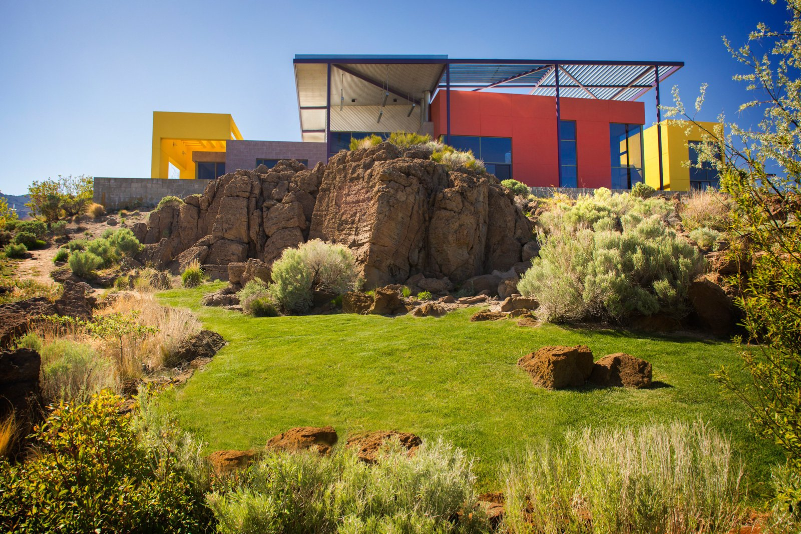 "The exterior palette of red and yellow recalls the Sierra Nevada range. ""When you combine them, it's an orange, which is the color of life,"" said Mack. ""The color of universal wellbeing and energy.""  Photo 9 of 9 in The Intersection of Art and Architecture Offered for $3.75M"