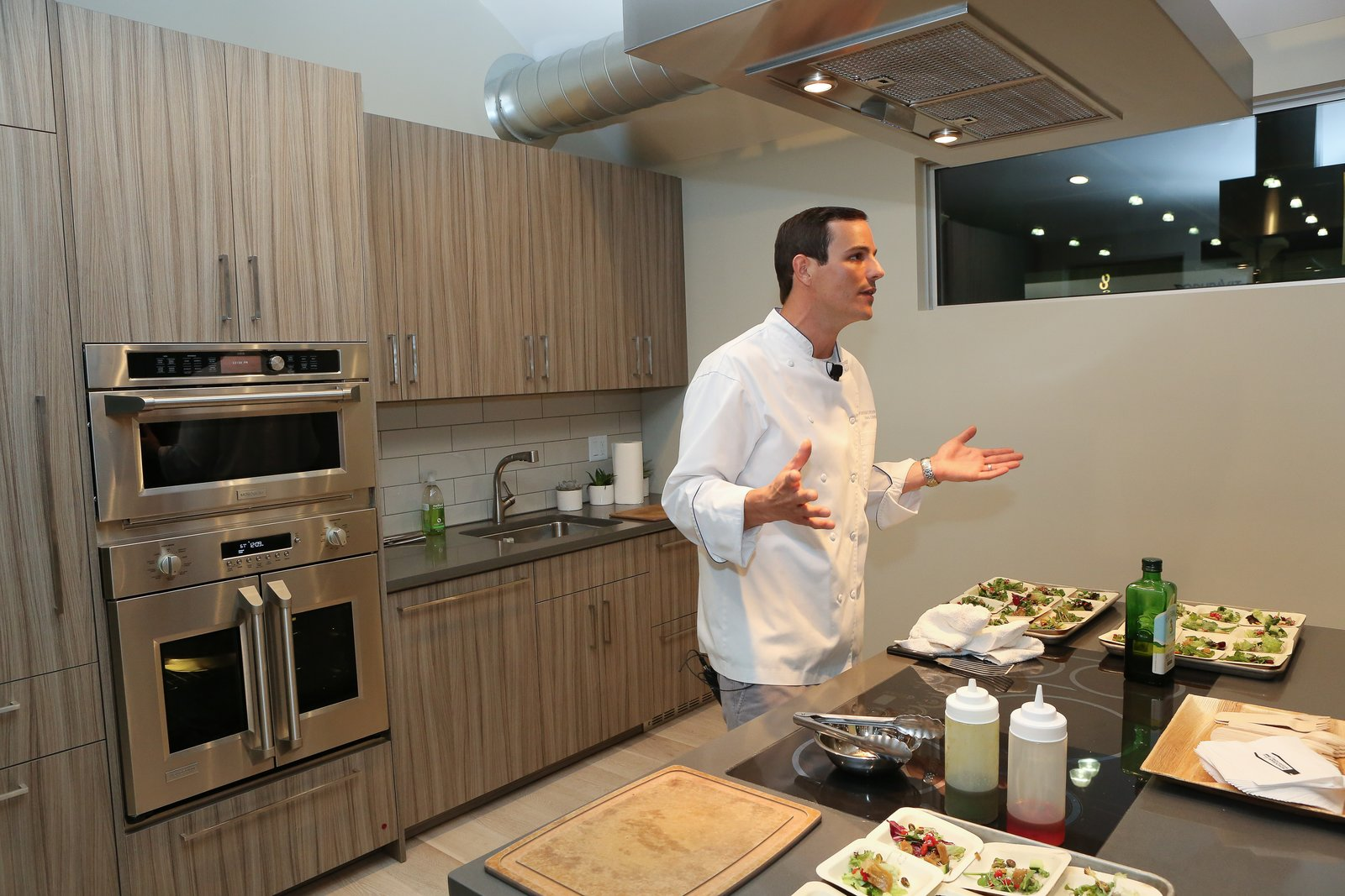 Liddell demonstrated the versatile, user-friendly features of Monogram appliances such as the induction cooktop, which boasts glide touch controls and an LED display.  Photo 4 of 6 in Monogram Modern Home Tour Joins the Los Angeles Design Scene