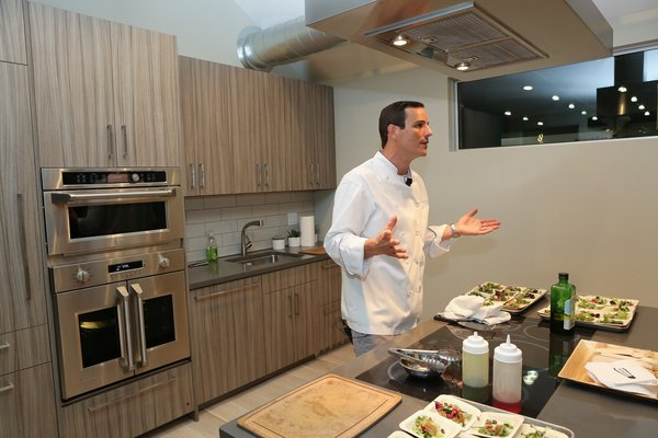 Monogram Modern Home Tour Joins the Los Angeles Design Scene - Photo 3 of 5 - Liddell demonstrated the versatile, user-friendly features of Monogram appliances such as the induction cooktop, which boasts glide touch controls and an LED display.