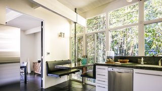 Own a Piece of Hollywood History for $1.995M - Photo 4 of 9 - Booth seating in the eat-in kitchen creates a cozy nook behind a private bamboo fence.