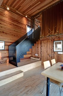 Agrarian Pastime: Book a Village Stay in Nova Scotia - Photo 2 of 13 - Natural cedar lines the interior of Hirtles, which was upgraded to include a second bathroom and a jacuzzi tub that looks out onto the white sands of Hirtles Beach.