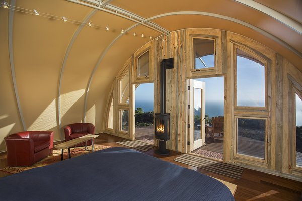 The tent fabric guards against the torrential wind and rain that can sweep through Big Sur. Parr customized the entryway to maximize the view.