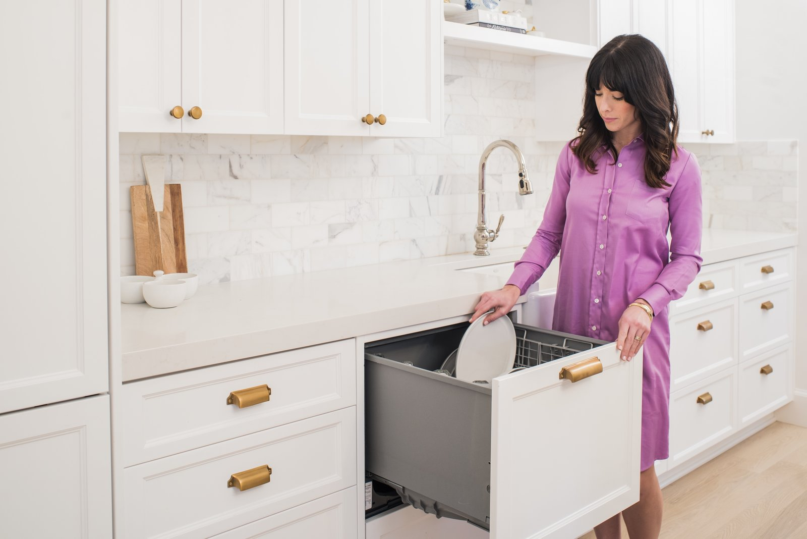 The dishwasher slides out like a drawer and doesn't require you to crouch to load dishes. Folding tines allow for large pots, bowls, and plates up to 13  Photo 5 of 8 in An Interior Designer's Streamlined Kitchen