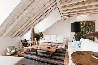 Baixa House Lets Travelers Be at Home in Lisbon - Photo 8 of 10 - Ultramar is the largest apartment in the building with three bedrooms and two bathrooms. The original wooden beams were left exposed and painted white, and the skylights were restored to allow for natural light.