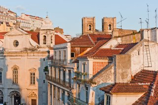 Baixa House Lets Travelers Be at Home in Lisbon - Photo 9 of 10 - From the main bedroom, guests can look out over the Baixa skyline, which features the Madalena church and the rooftops of Alfama and Se Cathedral.