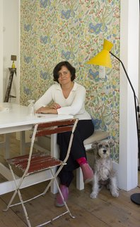 Baixa House Lets Travelers Be at Home in Lisbon - Photo 10 of 10 - Ulecia, pictured here with her dog Lola, strives to make Baixa House a personalized experience from the personally arranged flowers to the well-stocked kitchens in every apartment.