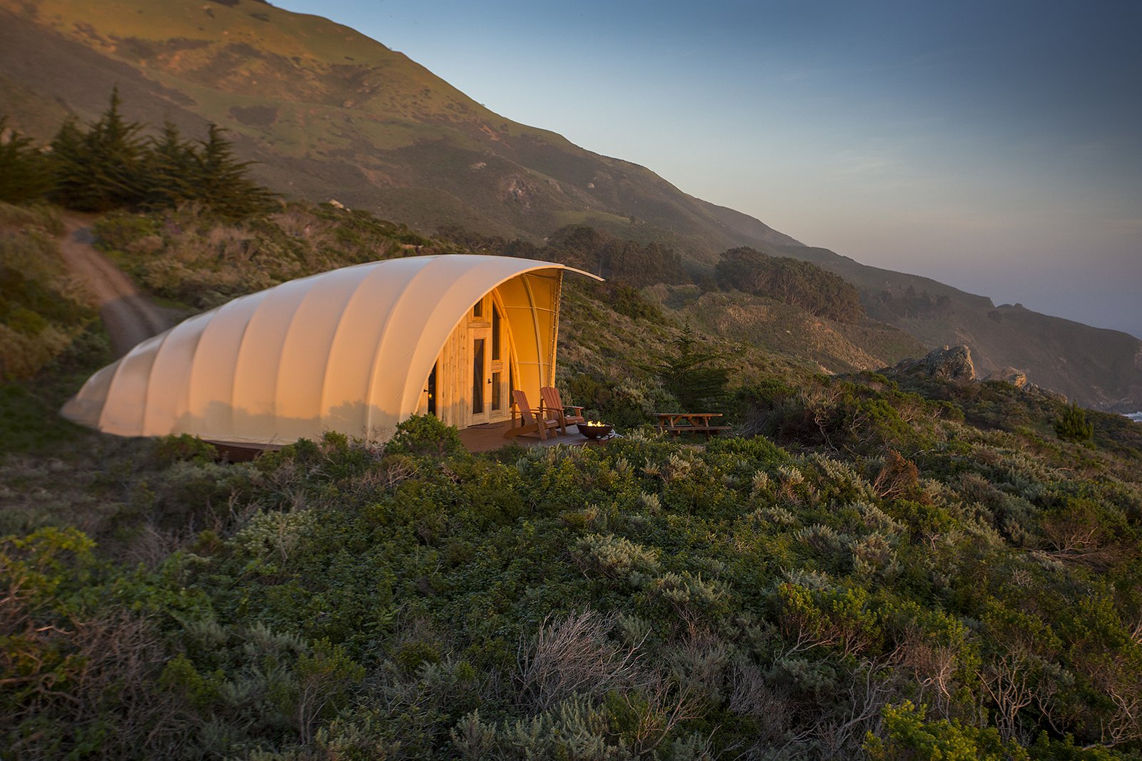 Tagged: Outdoor, Slope, Small Patio, Porch, Deck, Trees, Grass, and Shrubs.  Photo 1 of 5 in Sleep in a Translucent Cocoon for $495 a Night from Modern Nomads