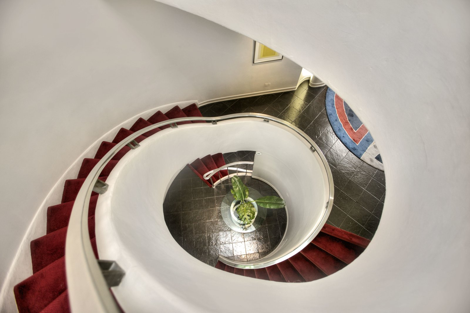A spiraling staircase connects the home's three levels and leads into the foyer. A Curvaceous Connecticut Home Asks $2.6M - Photo 5 of 9