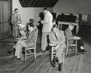 """This Book Unearths a Midcentury Personality Study on Architectural Giants - Photo 2 of 13 - The IPAR staff conducts a practice run of the Bingo Test, a """"situational procedure involving group interaction."""" Wallace Hall, the institute's chief deputy, is seated in front."""